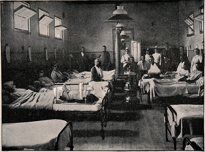 V0015578 Boer War: a hospital ward with soldiers wounded during the s Credit: Wellcome Library, London. Wellcome Images images@wellcome.ac.uk http://wellcomeimages.org Boer War: a hospital ward with soldiers wounded during the siege of Kimberley, South Africa. Process print after Bennett, 1899. 1899 By: BennettPublished: 1899] Copyrighted work available under Creative Commons Attribution only licence CC BY 4.0 http://creativecommons.org/licenses/by/4.0/